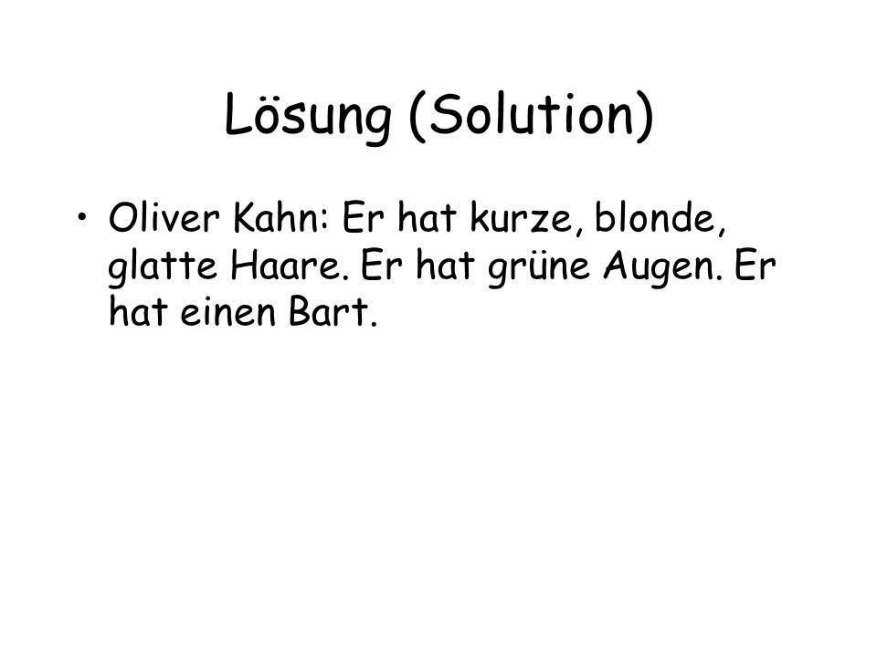 Lösung (Solution) Oliver Kahn: Er hat kurze, blonde, glatte Haare. Er hat grüne Augen. Er hat einen Bart.