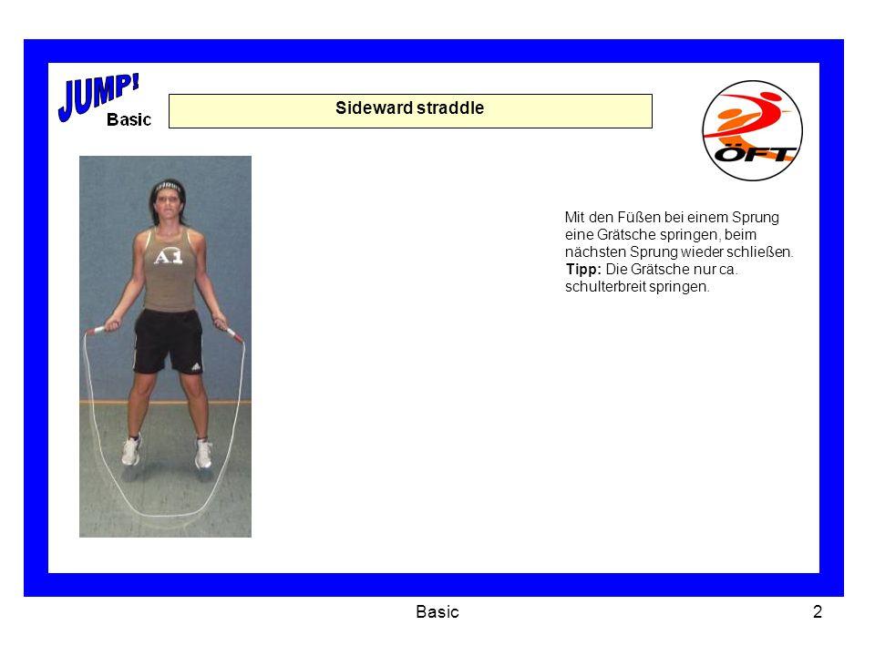 Basic3 Forward straddle In Schrittstellung springen.
