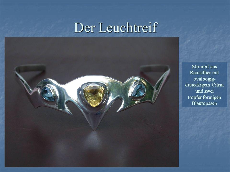 Stirnreif aus Reinsilber mit ovalbogig- dreieckigem Citrin und zwei tropfenförmigen Blautopasen Der Leuchtreif