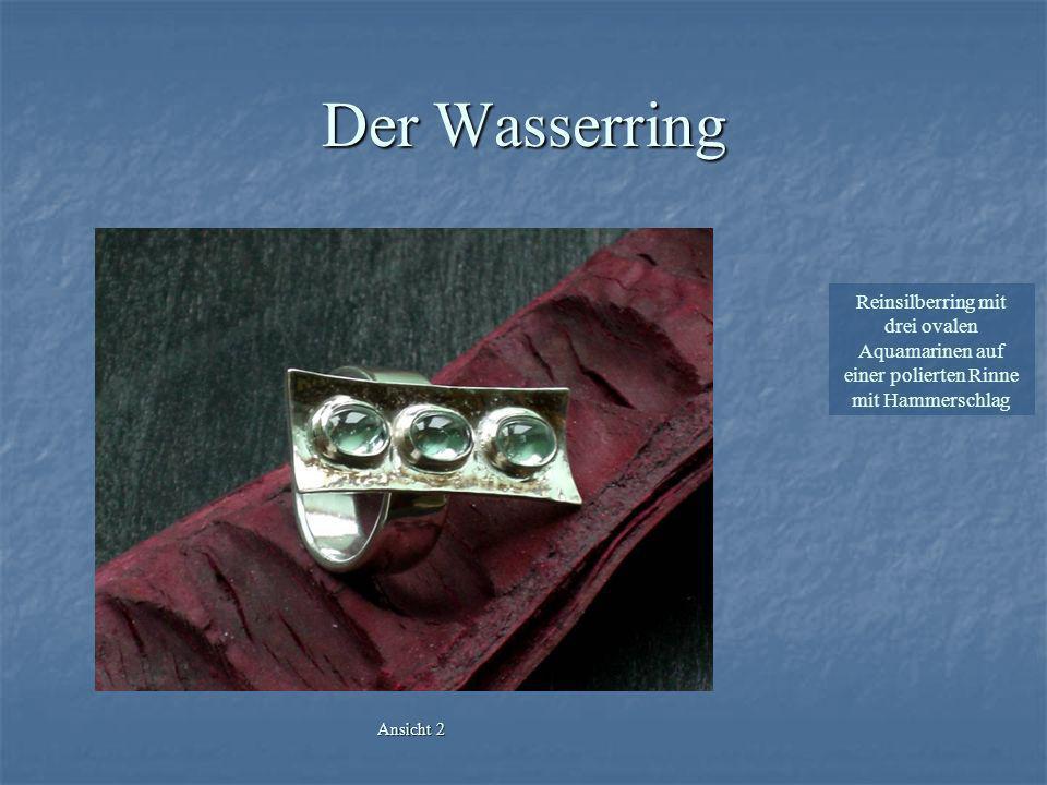Der Herrenring Reinsilberring mit einem facettierten Rauchquarz, gehalten durch vernietete Backen mit mattierter Oberfläche Ansicht 1