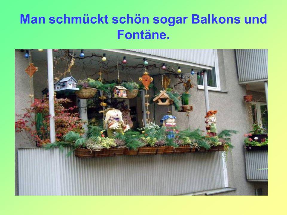 Man schmückt schön sogar Balkons und Fontäne.
