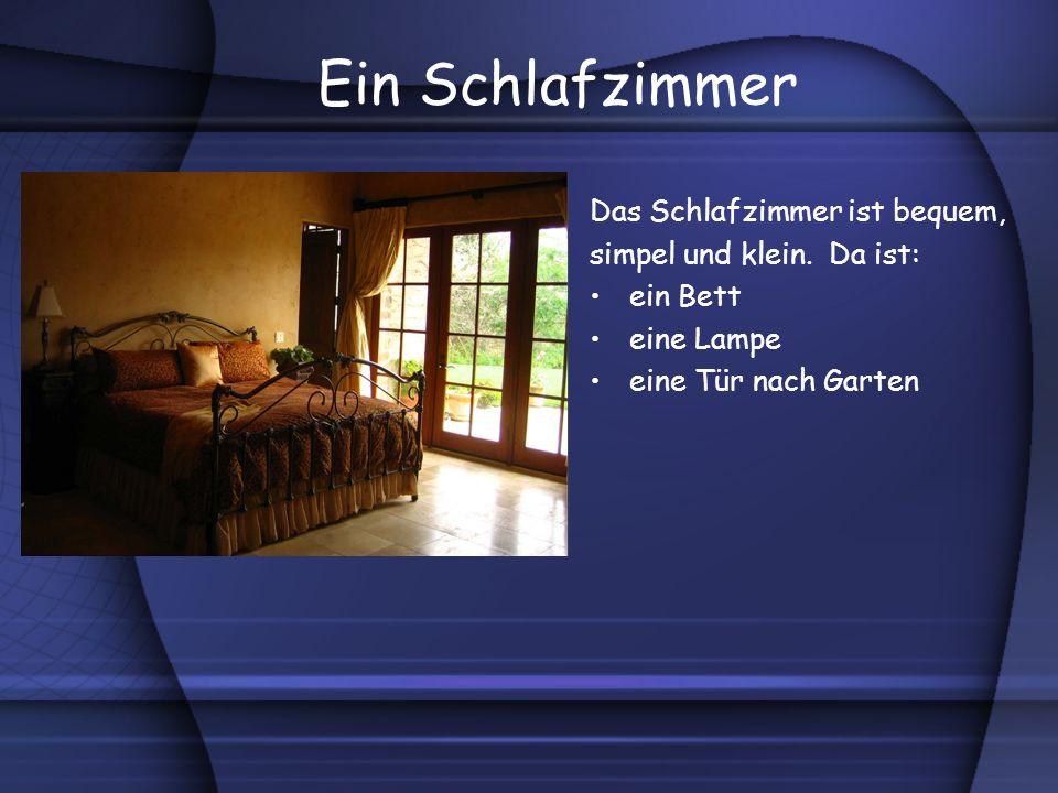 Ein Schlafzimmer Das Schlafzimmer ist bequem, simpel und klein. Da ist: ein Bett eine Lampe eine Tür nach Garten