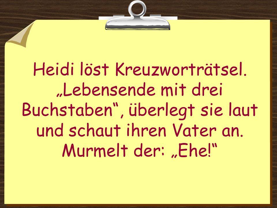 Heidi löst Kreuzworträtsel.