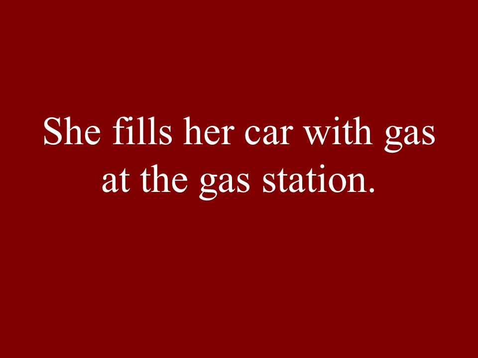 She fills her car with gas at the gas station.