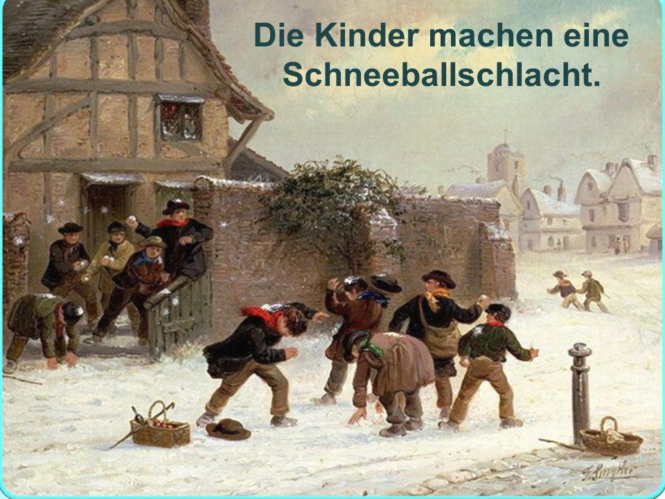 Die Kinder machen eine Schneeballschlacht.