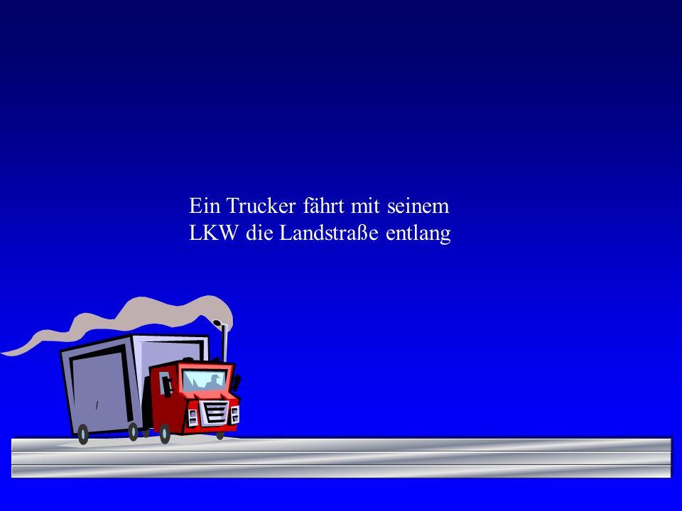 / Ein Trucker fährt mit seinem LKW die Landstraße entlang