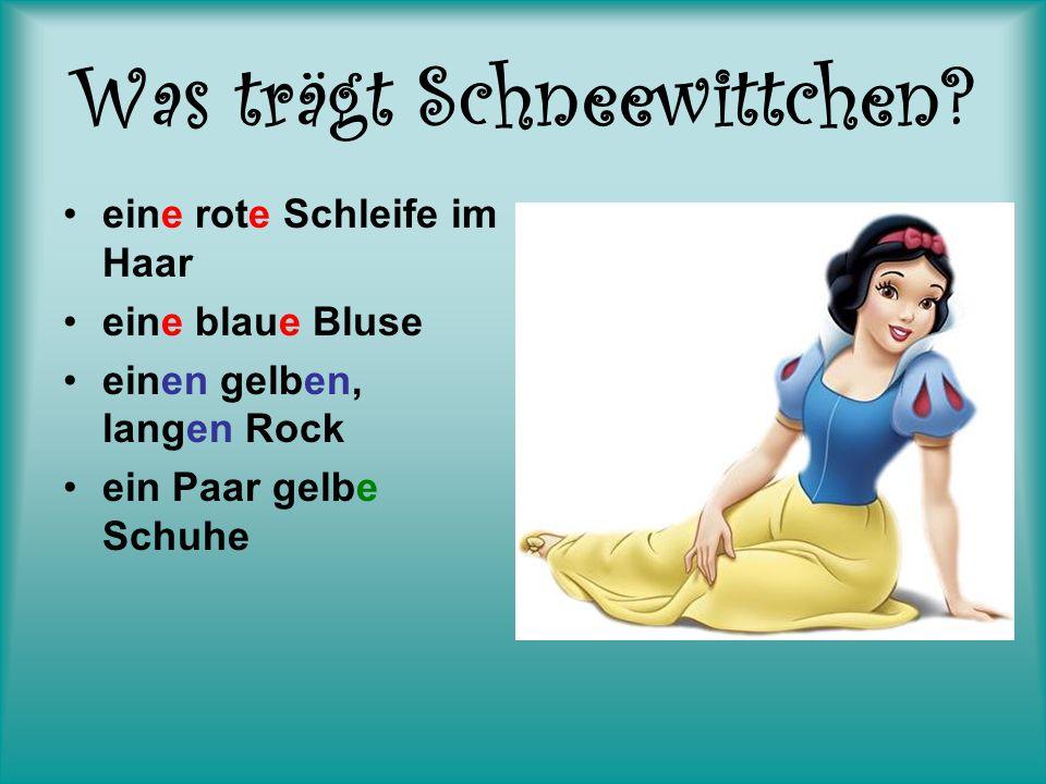 Was trägt Schneewittchen? eine rote Schleife im Haar eine blaue Bluse einen gelben, langen Rock ein Paar gelbe Schuhe