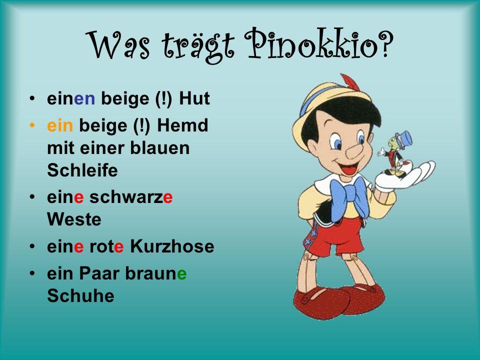 Was trägt Pinokkio? einen beige (!) Hut ein beige (!) Hemd mit einer blauen Schleife eine schwarze Weste eine rote Kurzhose ein Paar braune Schuhe