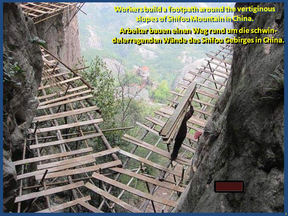 1 Workers build a footpath around the vertiginous slopes of Shifou Mountain in China. Arbeiter bauen einen Weg rund um die schwin- delerregenden Wände