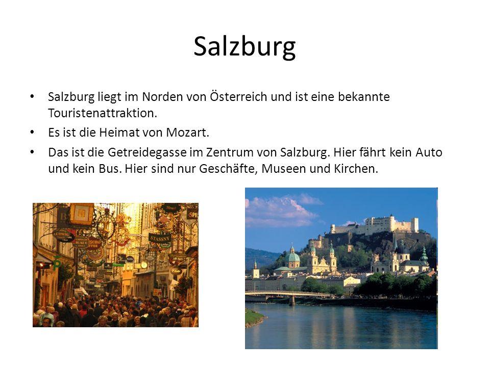 Salzburg Salzburg liegt im Norden von Österreich und ist eine bekannte Touristenattraktion. Es ist die Heimat von Mozart. Das ist die Getreidegasse im