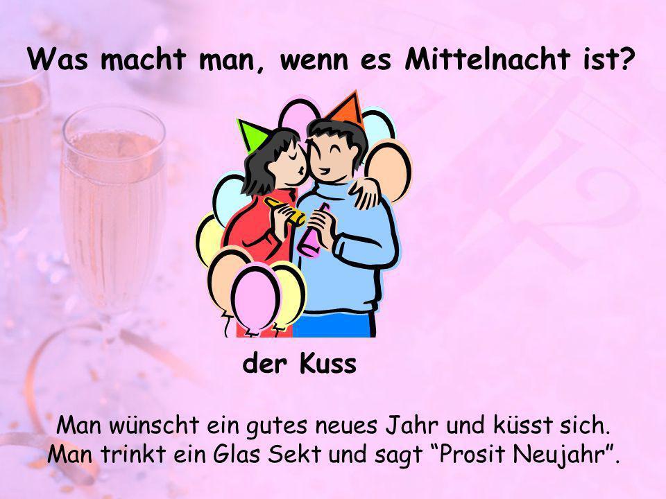 Was macht man, wenn es Mittelnacht ist? Man wünscht ein gutes neues Jahr und küsst sich. Man trinkt ein Glas Sekt und sagt Prosit Neujahr. der Kuss