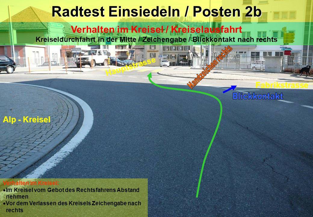 Radtest Einsiedeln / Posten 2b Verhalten im Kreisel / Kreiselausfahrt Kreiseldurchfahrt in der Mitte / Zeichengabe / Blickkontakt nach rechts Hauptstr