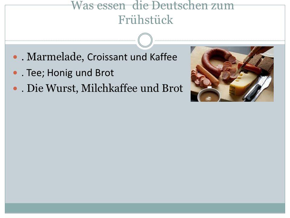 Was essen die Deutschen zum Frühstück. Marmelade, Croissant und Kaffee.