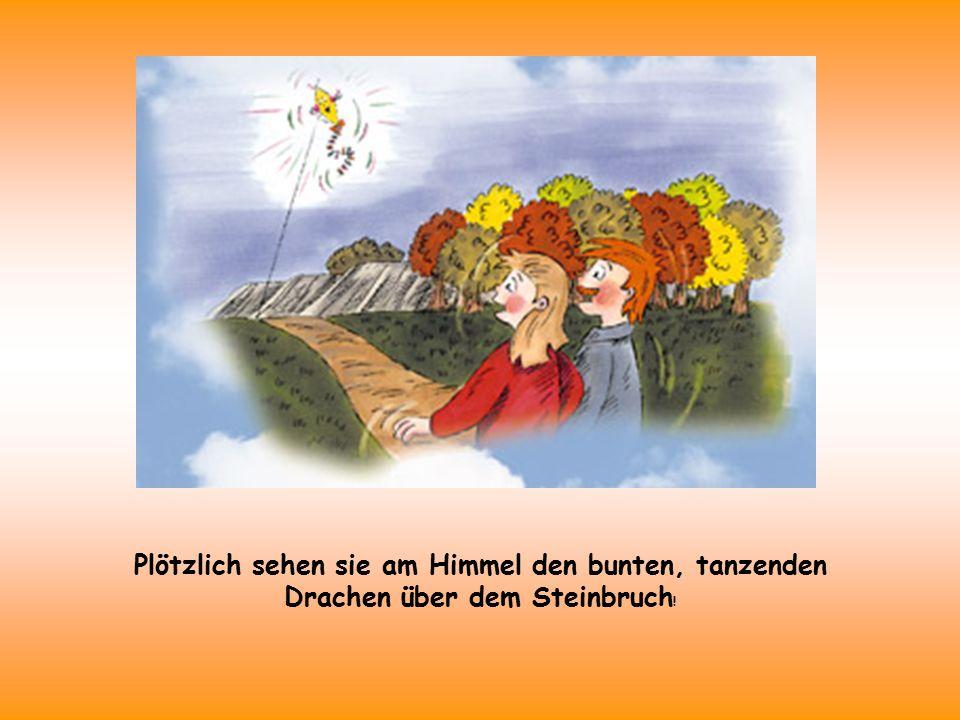Plötzlich sehen sie am Himmel den bunten, tanzenden Drachen über dem Steinbruch !
