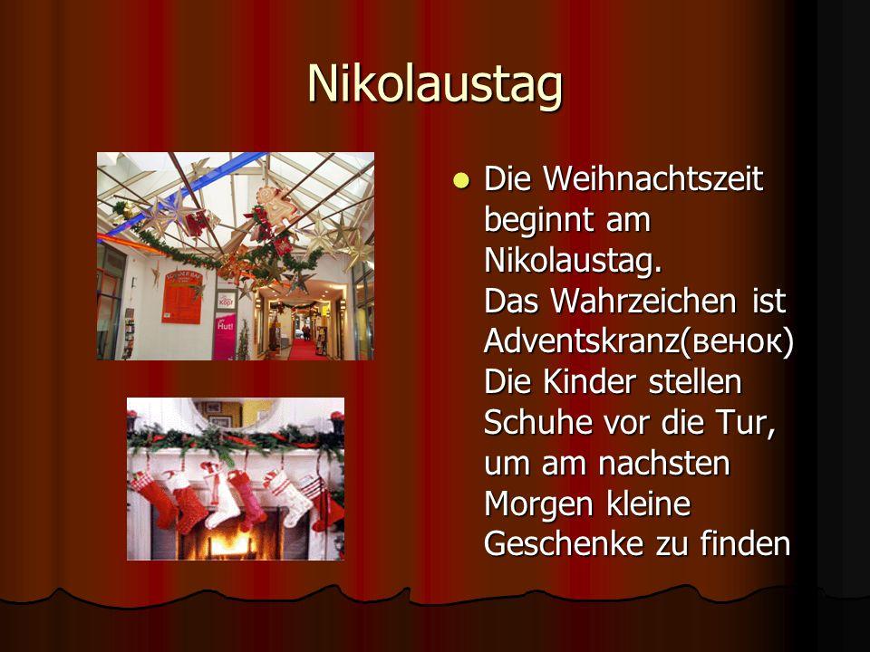Nikolaustag Die Weihnachtszeit beginnt am Nikolaustag. Das Wahrzeichen ist Adventskranz(венок) Die Kinder stellen Schuhe vor die Tur, um am nachsten M