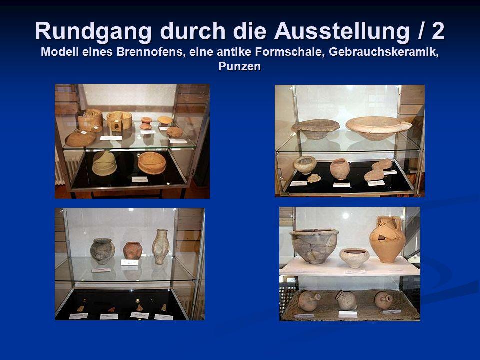 Rundgang durch die Ausstellung / 2 Modell eines Brennofens, eine antike Formschale, Gebrauchskeramik, Punzen