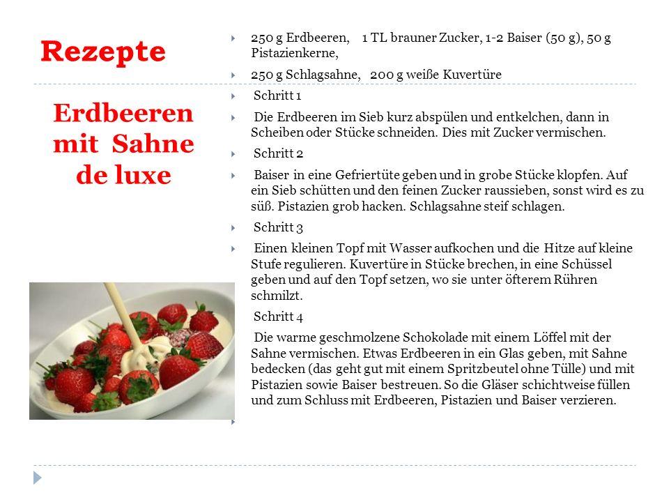 Rezepte Erdbeeren mit Sahne de luxe  250 g Erdbeeren, 1 TL brauner Zucker, 1-2 Baiser (50 g), 50 g Pistazienkerne,  250 g Schlagsahne, 200 g weiße Kuvertüre  Schritt 1  Die Erdbeeren im Sieb kurz abspülen und entkelchen, dann in Scheiben oder Stücke schneiden.