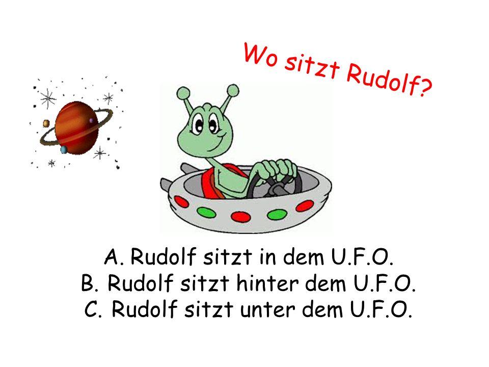 Wo sitzt Rudolf. A.Rudolf sitzt in dem U.F.O. B.Rudolf sitzt hinter dem U.F.O.