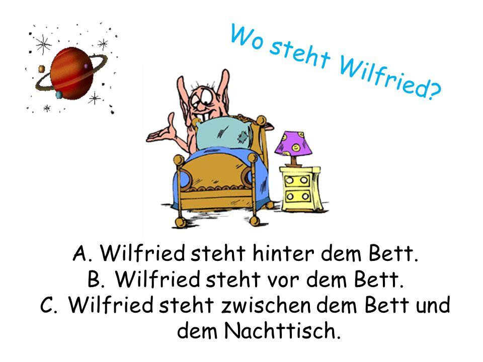 Wo steht Wilfried. A.Wilfried steht hinter dem Bett.