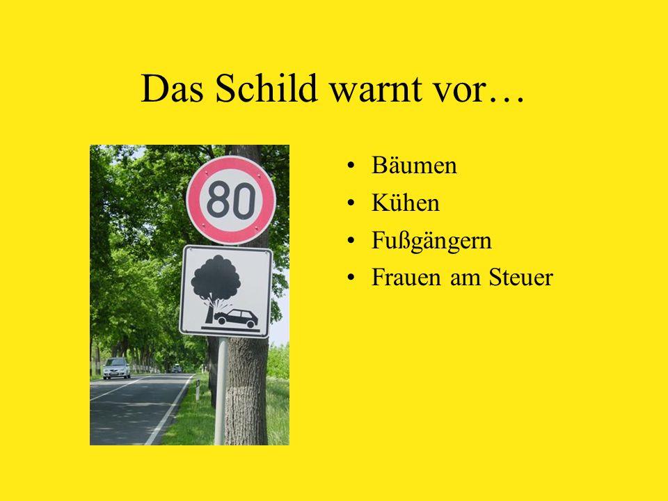 Das Schild warnt vor… Bäumen Kühen Fußgängern Frauen am Steuer