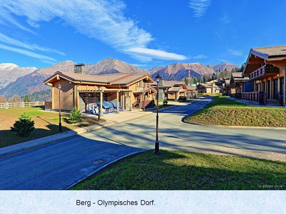 Das olympische Dorf II. Überall sind große Gebäude.