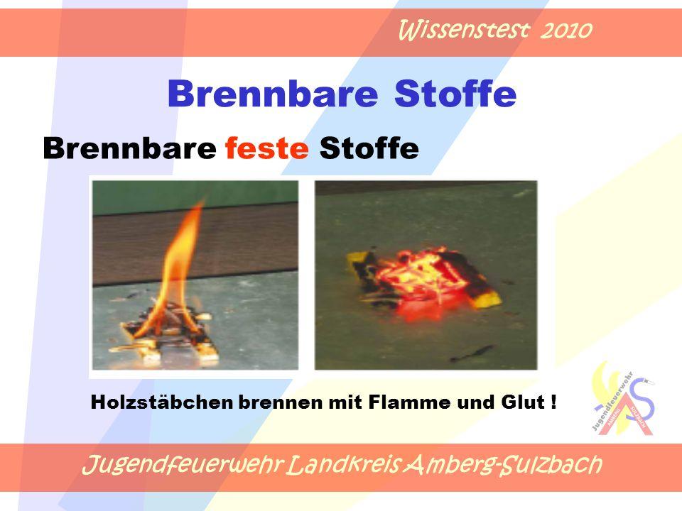 Jugendfeuerwehr Landkreis Amberg-Sulzbach Wissenstest 2010 Brennbare Stoffe Holzstäbchen brennen mit Flamme und Glut .