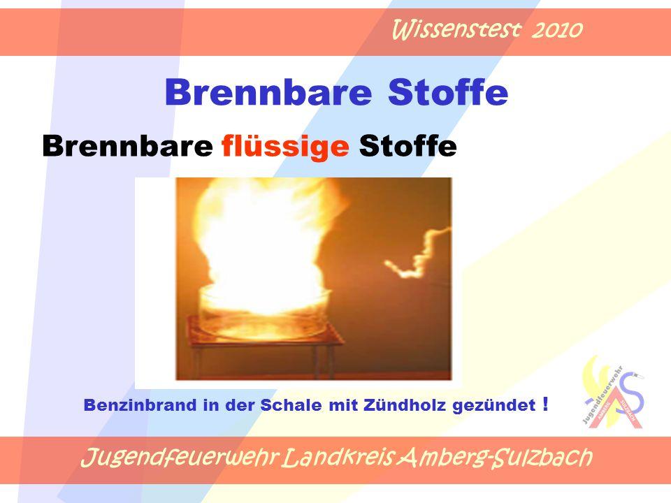 Jugendfeuerwehr Landkreis Amberg-Sulzbach Wissenstest 2010 Brennbare Stoffe Benzinbrand in der Schale mit Zündholz gezündet .