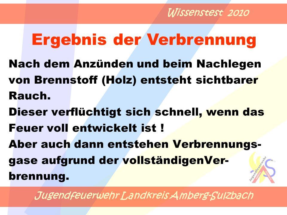Jugendfeuerwehr Landkreis Amberg-Sulzbach Wissenstest 2010 Nach dem Anzünden und beim Nachlegen von Brennstoff (Holz) entsteht sichtbarer Rauch.