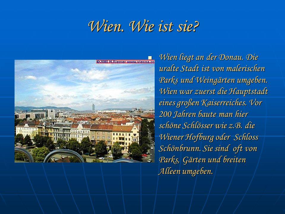 Wien. Wie ist sie? Wien Wien liegt an der Donau. Die uralte Stadt ist von malerischen Parks und Weingärten umgeben. Wien war zuerst die Hauptstadt ein