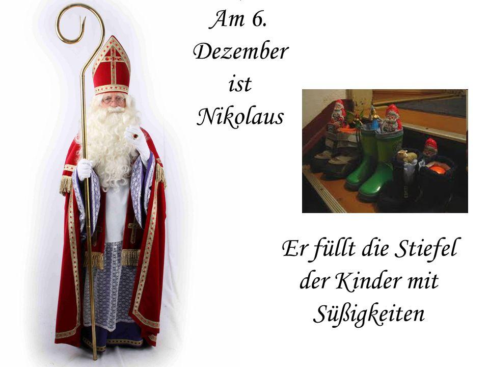 Am 6. Dezember ist Nikolaus Er füllt die Stiefel der Kinder mit Süßigkeiten
