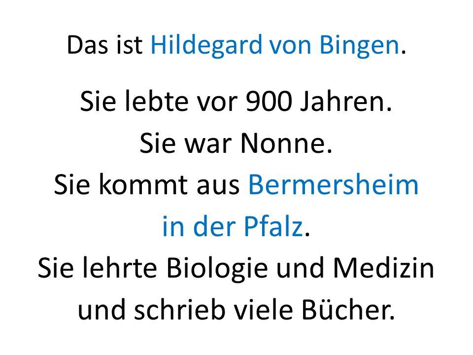 Das ist Hildegard von Bingen. Sie lebte vor 900 Jahren. Sie war Nonne. Sie kommt aus Bermersheim in der Pfalz. Sie lehrte Biologie und Medizin und sch