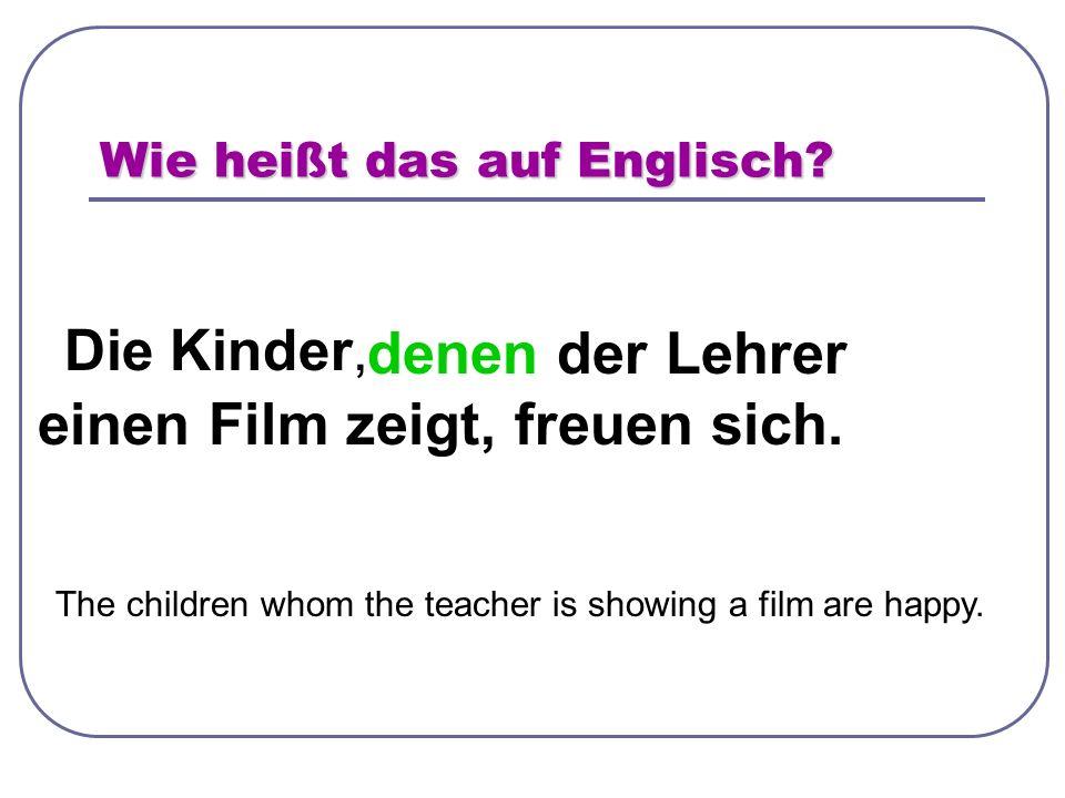 Wie heißt das auf Englisch. Die Kinder, denen der Lehrer einen Film zeigt, freuen sich.