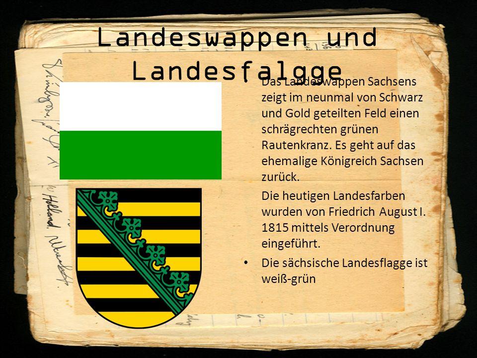 Landeswappen und Landesfalgge Das Landeswappen Sachsens zeigt im neunmal von Schwarz und Gold geteilten Feld einen schrägrechten grünen Rautenkranz.
