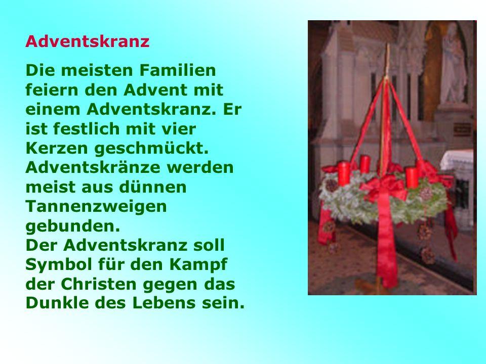 Adventskranz Die meisten Familien feiern den Advent mit einem Adventskranz.