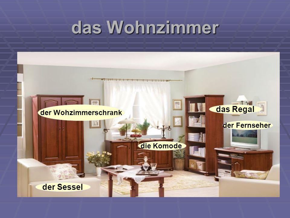 das Wohnzimmer der Wohzimmerschrank die Komode das Regal der Fernseher der Sessel