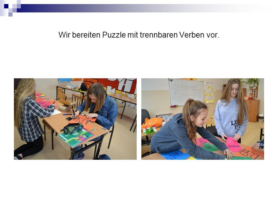 Wir bereiten Puzzle mit trennbaren Verben vor.