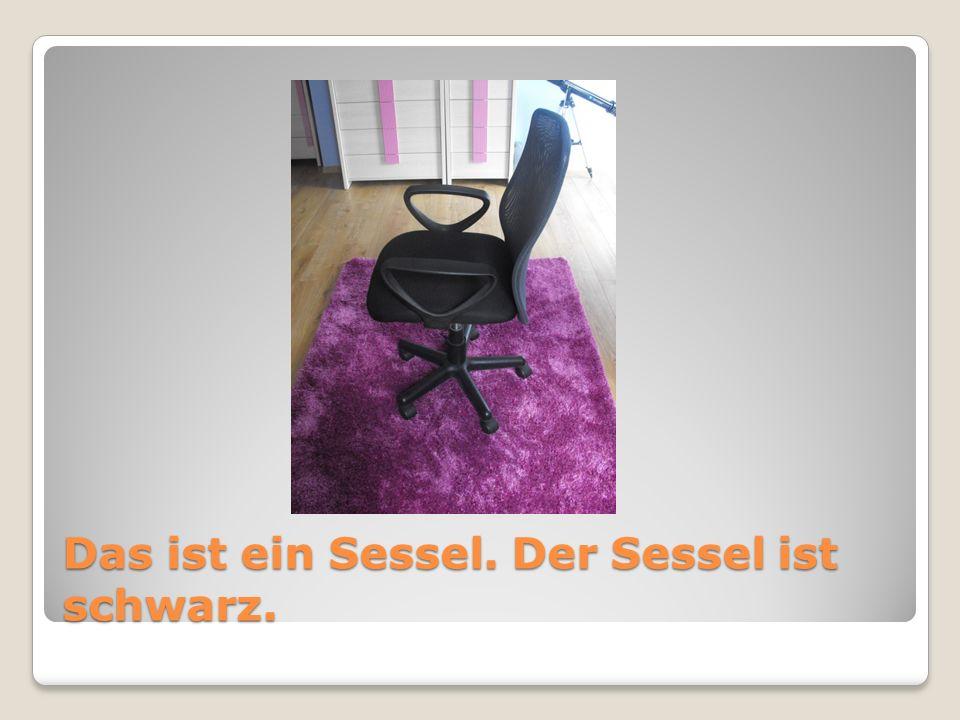 Das ist ein Sessel. Der Sessel ist schwarz.