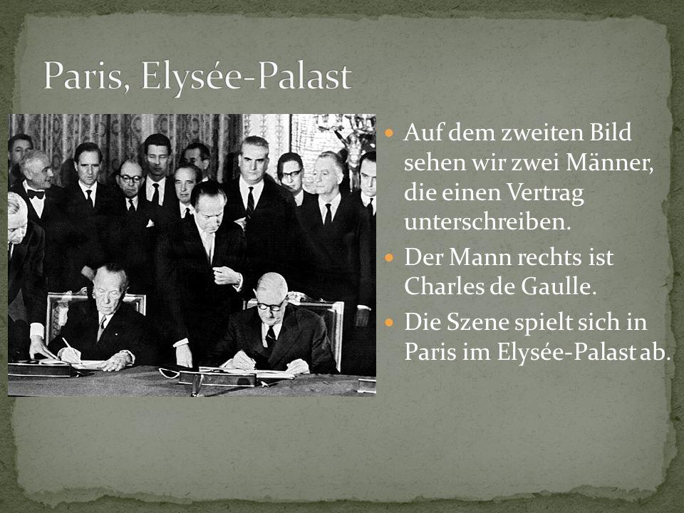 Auf dem zweiten Bild sehen wir zwei Männer, die einen Vertrag unterschreiben. Der Mann rechts ist Charles de Gaulle. Die Szene spielt sich in Paris im