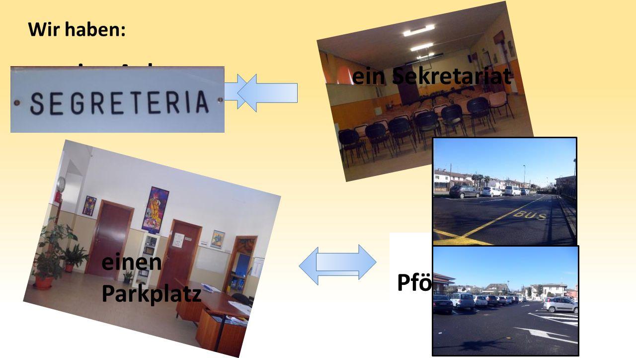 eine Aula Magna eine Pförtnerloge Wir haben: ein Sekretariat einen Parkplatz