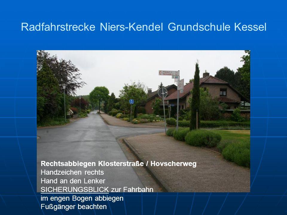Radfahrstrecke Niers-Kendel Grundschule Kessel Rechtsabbiegen Klosterstraße / Hovscherweg Handzeichen rechts Hand an den Lenker SICHERUNGSBLICK zur Fahrbahn im engen Bogen abbiegen Fußgänger beachten
