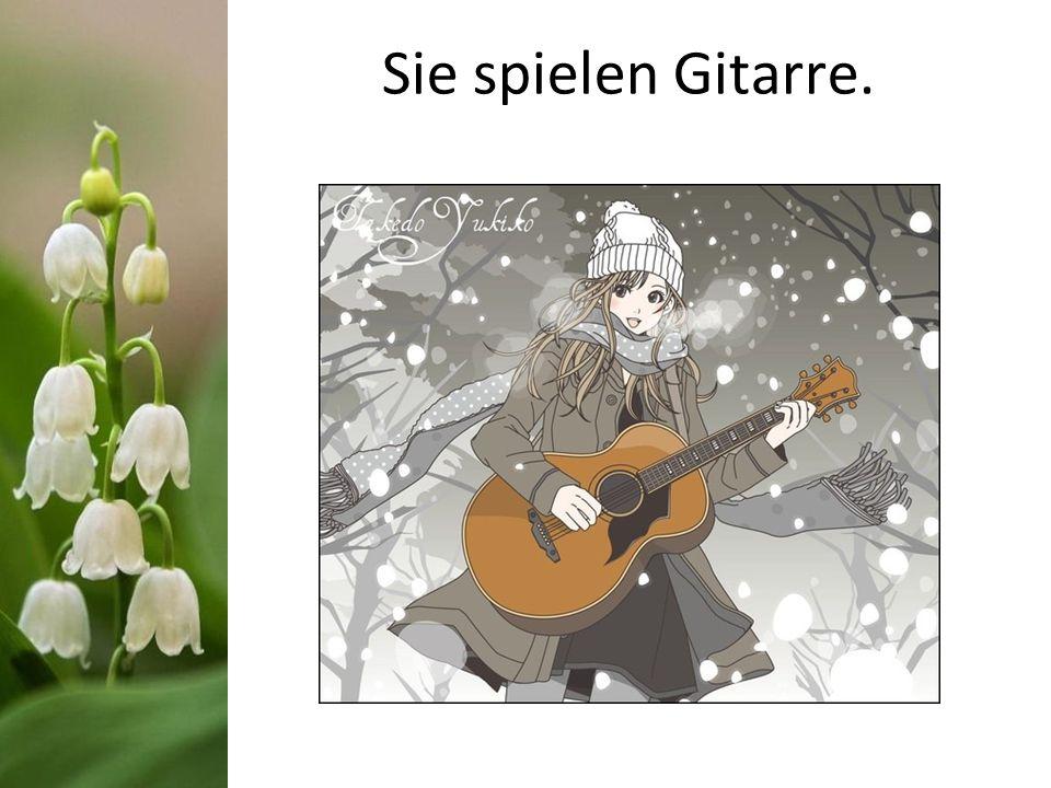 Sie spielen Gitarre.