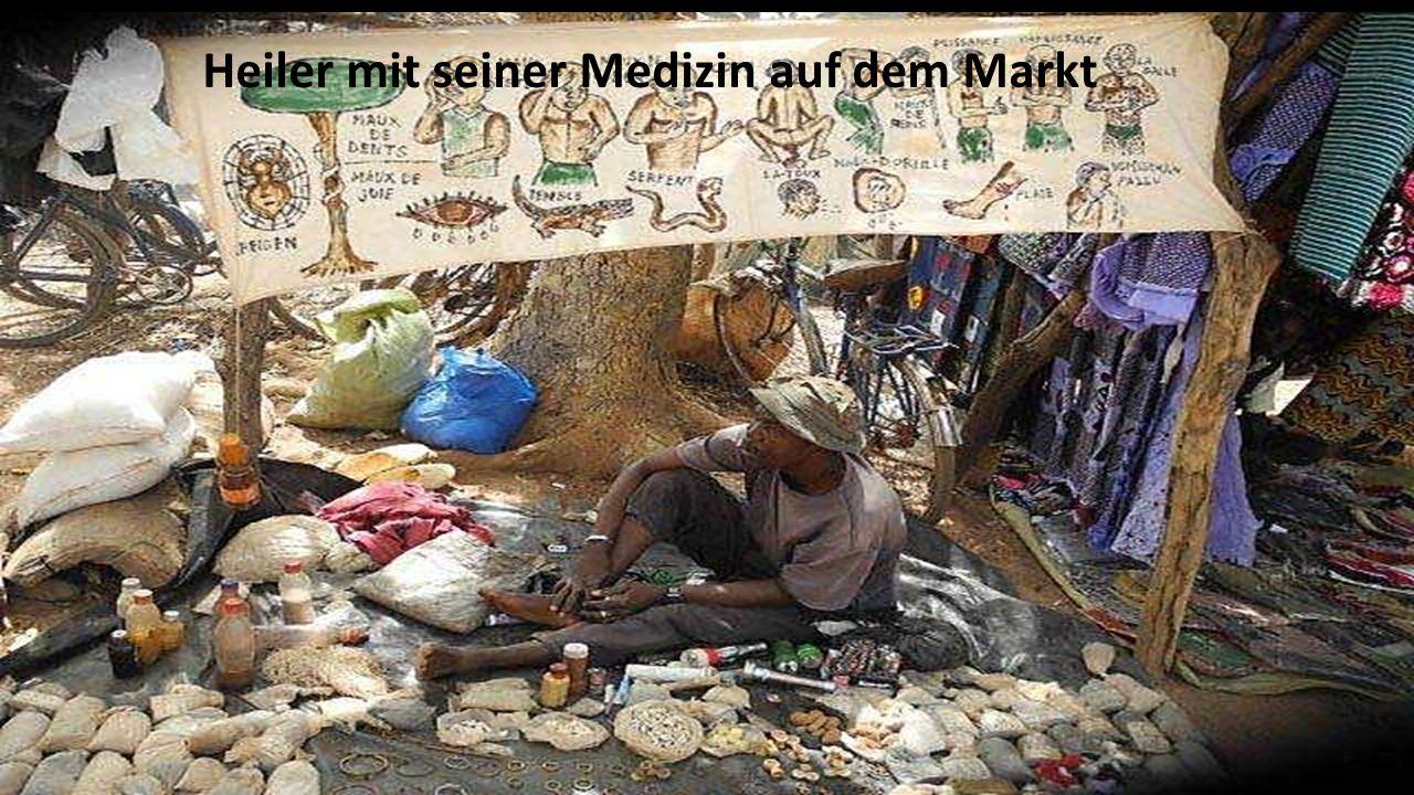 Heiler mit seiner Medizin auf dem Markt