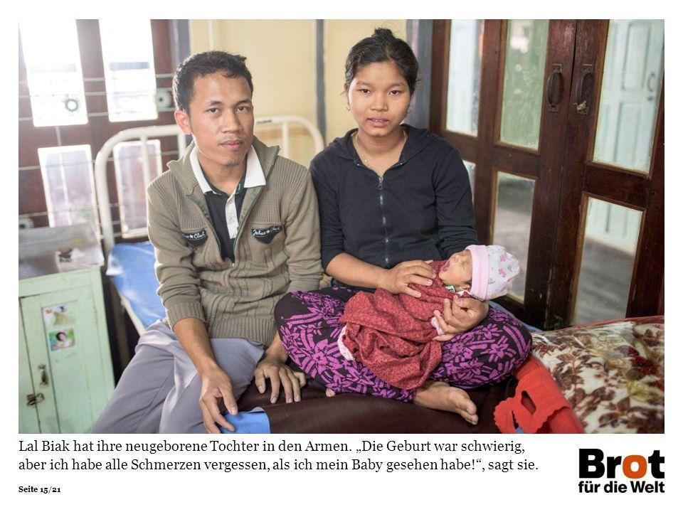 Seite 15/21 Lal Biak hat ihre neugeborene Tochter in den Armen.