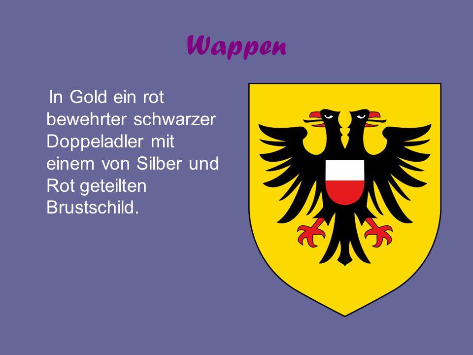 Wappen In Gold ein rot bewehrter schwarzer Doppeladler mit einem von Silber und Rot geteilten Brustschild.