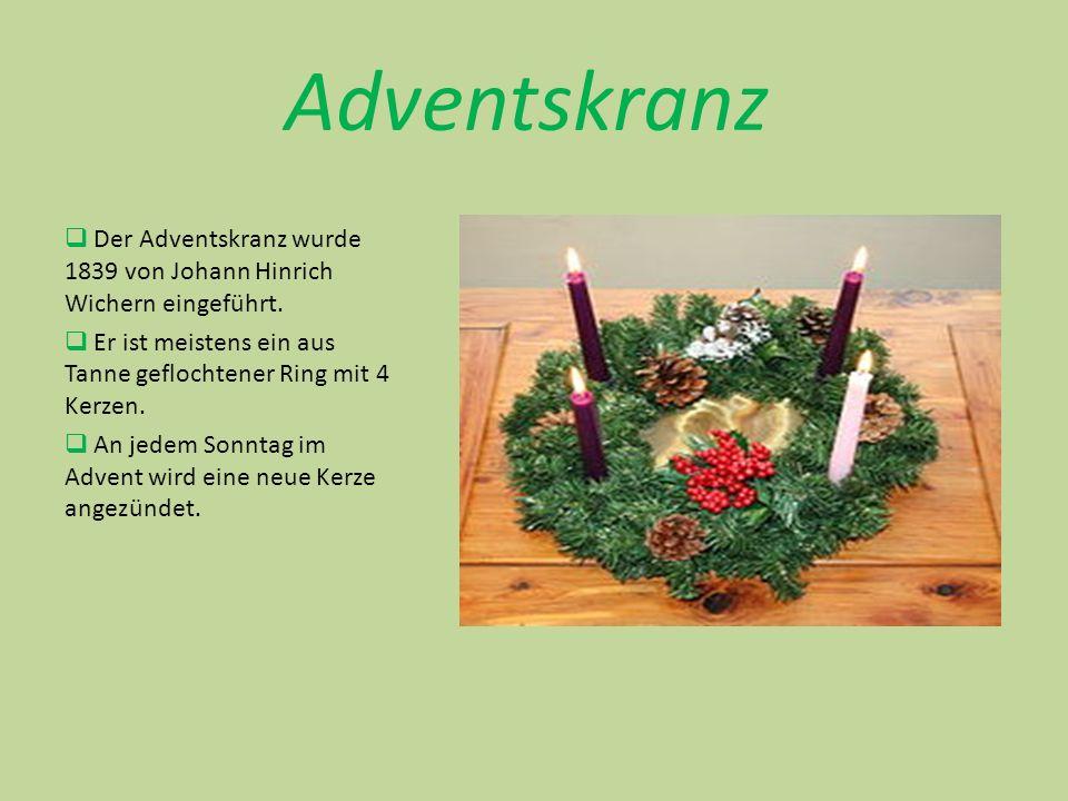 Weihnachtskranz Während der Adventszeit dient der Weihnachtskranz als Dekoration auf dem Tisch oder an der Tür.