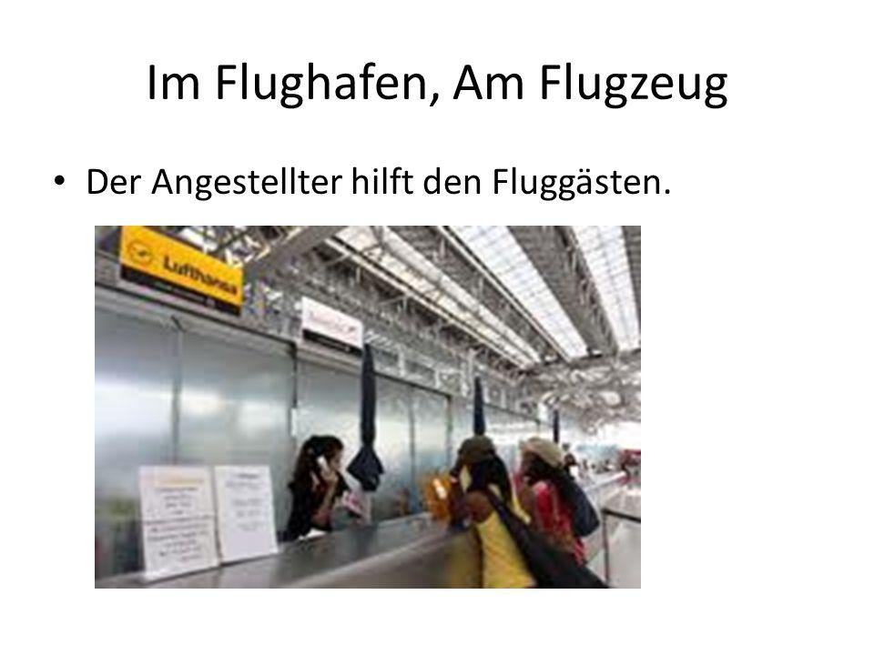 Im Flughafen, Am Flugzeug Der Angestellter hilft den Fluggästen.