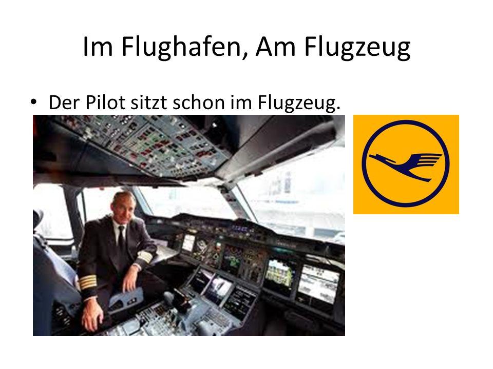 Im Flughafen, Am Flugzeug Der Pilot sitzt schon im Flugzeug.