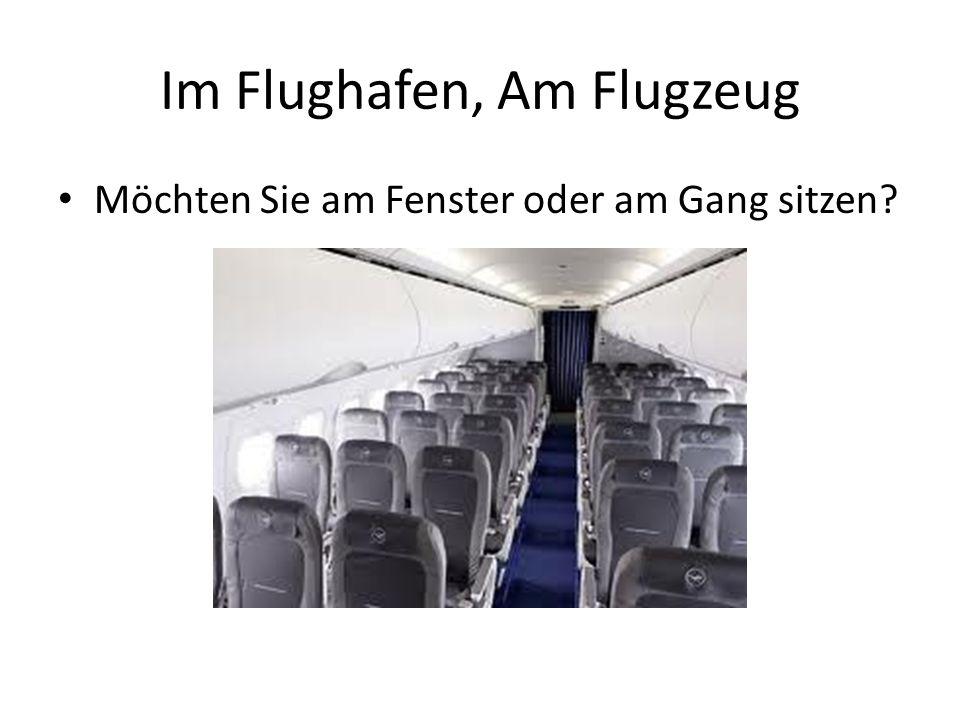 Im Flughafen, Am Flugzeug Möchten Sie am Fenster oder am Gang sitzen