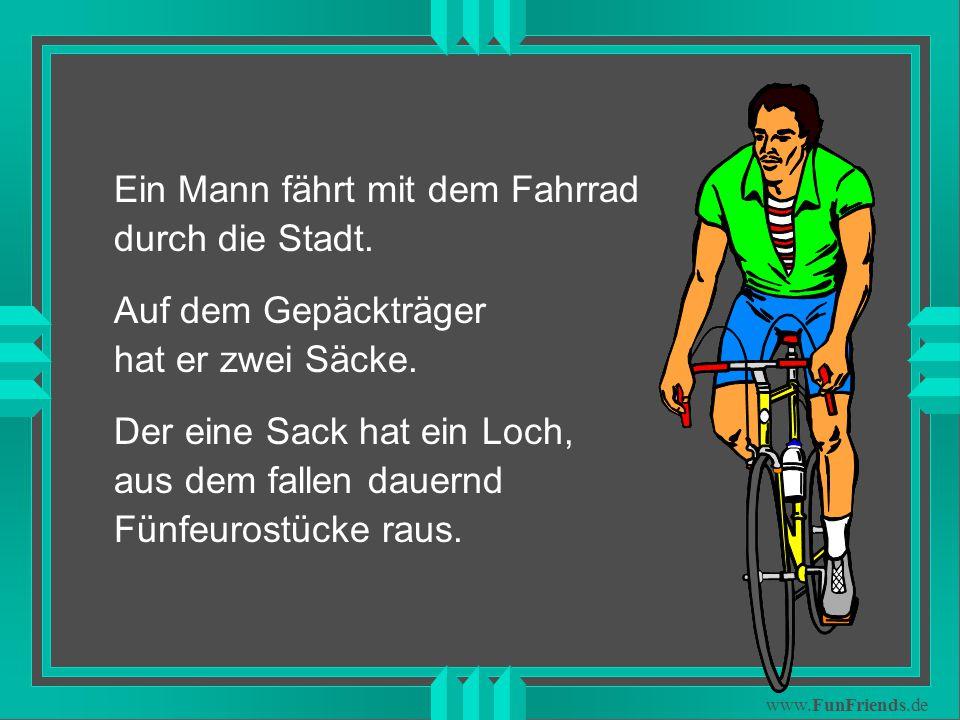 www.FunFriends.de Ein Mann fährt mit dem Fahrrad durch die Stadt.