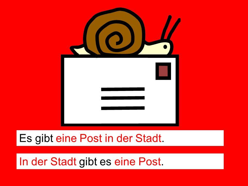 Es gibt eine Post in der Stadt. In der Stadt gibt es eine Post.